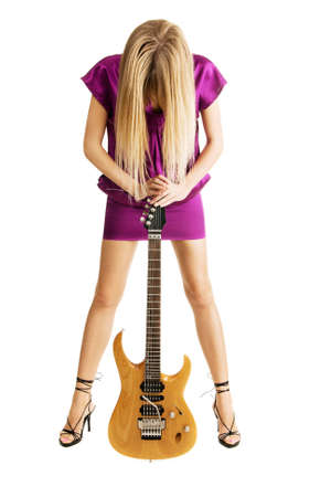 Hot girl playing an electric guitar, isolated on white background Stock Photo - 5929949