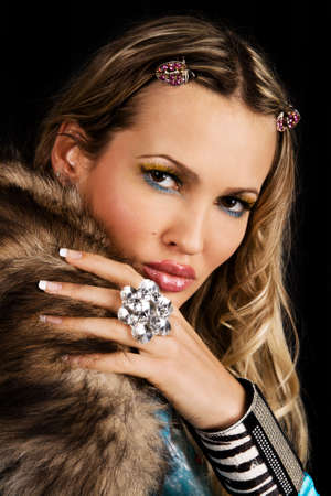 Young woman in luxury clothing and accessories photo