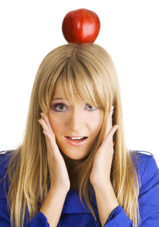 Funny frightened young woman with an apple on her head photo