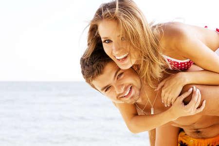 Beautiful young couple having fun on the seaside Stock Photo - 5929965