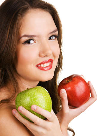 Young cheerful teenager with teeth  brackets, holding fresh apples. photo