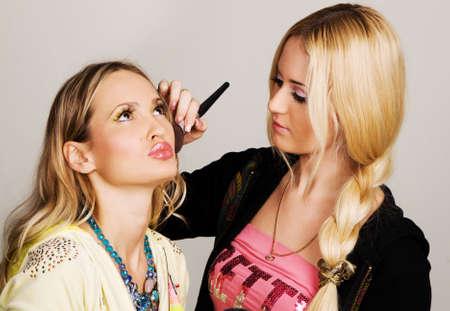 visagiste: Professional visagiste applying makeup to a model
