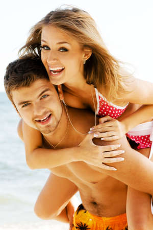 Young couple having fun on the seaside Stock Photo - 5966128