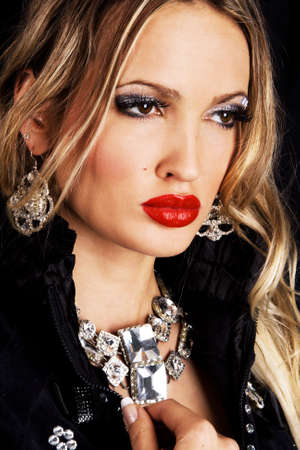 Fashion model with creative makeup and luxury jewelry photo