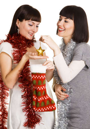 Two cheerful girls taking out their christmas presents photo