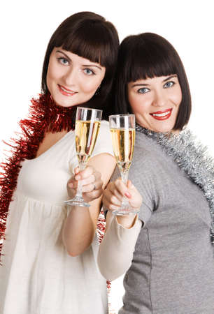 Two young women holding champagne glasses, white background photo