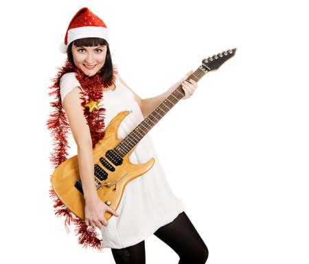 Joyful christmas girl with an electric guitar photo