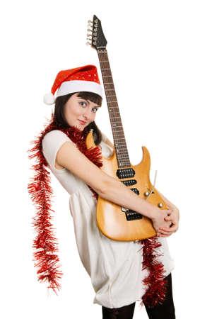 Joyful christmas girl with an electric guitar Stock Photo - 5978969