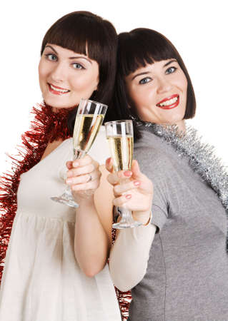 Two beautiful Christmas girls with champagne glasses photo