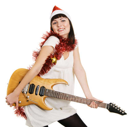 Cheerful Christmas girl with an electric guitar photo