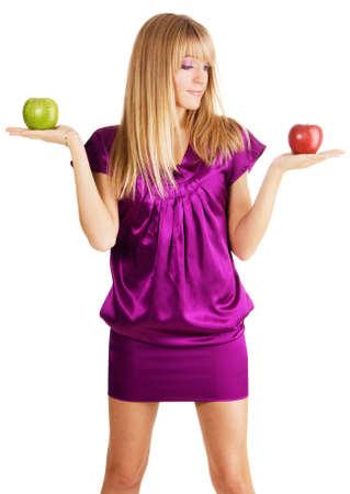 Young beautiful lady weighing two apples, isolated on white background photo