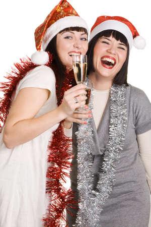Christmas girls holding champagne glasses, isolated on white background photo