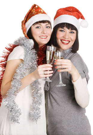 Christmas girls holding champagne glasses, isolated on white background photo