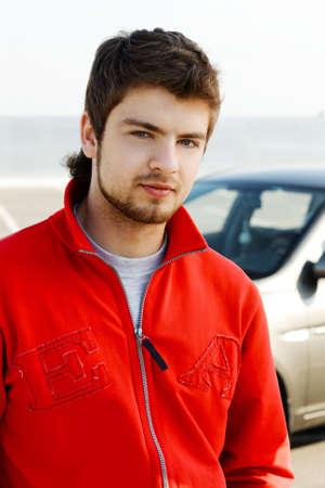 Hansdsome young man in red jacket photo