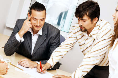 Young businessmen discussing a project photo