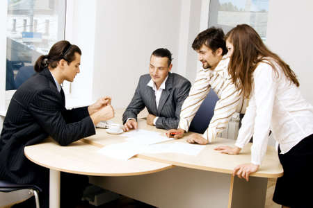 Business team having a discussion in office photo
