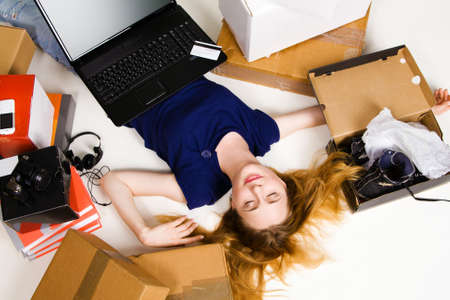 Young girl surrounded with her delivered online orders photo