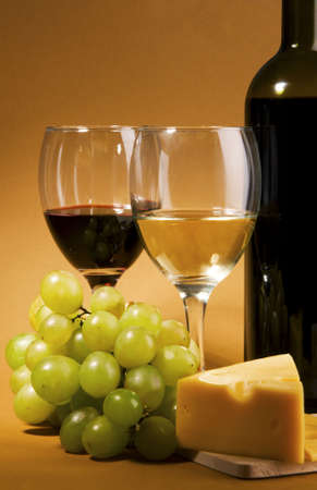 Wine, grapes and different  kinds of cheese still-life photo