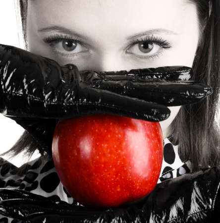 temptations: Gorgeous woman holding a vibrant red apple Stock Photo