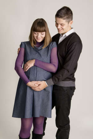 Beautiful pregnant woman with her husband studio portrait photo