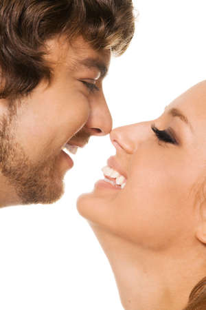 Young beautiful man and woman face portrait, white background photo