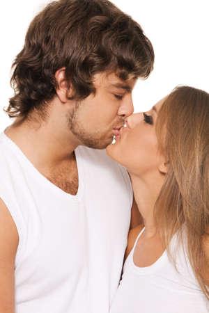 Beautiful yong couple kissing, closeup portrait photo