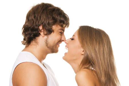 Young cheerful couple touched one another's nose Фото со стока