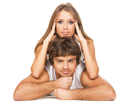 Beautiful young couple in casual clothing, white background  photo
