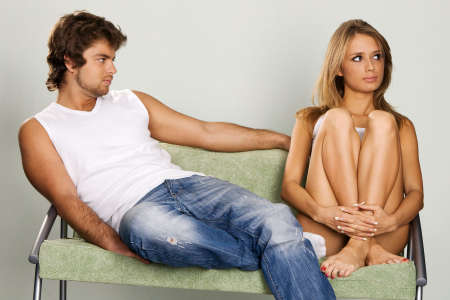 Young couple sitting on green sofa photo