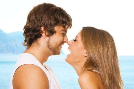 Young cheerful couple touching one anothers nose photo