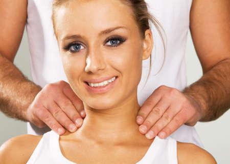 Happy young woman enjoying a massage, face portrait photo