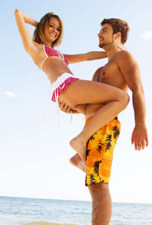 bikini couple: Romantic couple having fun on the seaside