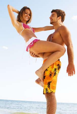Romantic couple having fun on the seaside photo