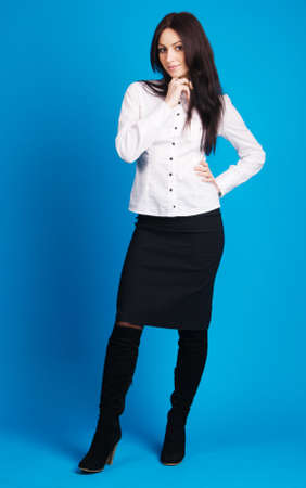 Beautiful businesswoman studio photo, blue background