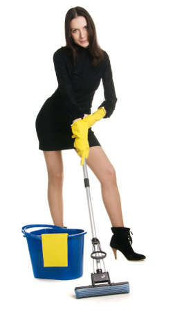 housewife gloves: Sexy housewife in elegant dress holding a swab and bucket, white background Stock Photo