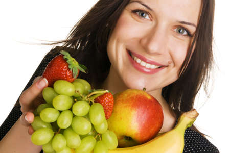 Beautiful young woman with a bunch of fruits photo