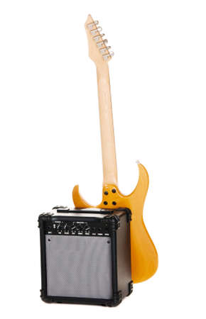 Electric guitar with amplifier, white background photo