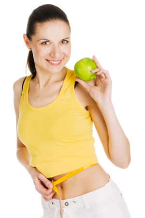 Beautiful slim woman holding a green apple, white background photo