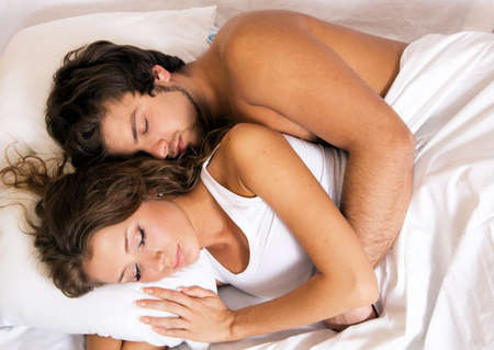 Young beautiful couple sleeping in bed Stock Photo - 6787392
