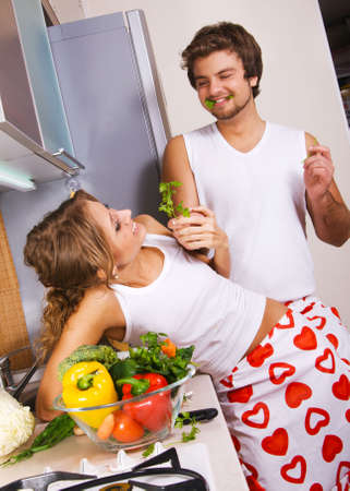 Young beautiful couple in their kitchen Stock Photo - 6787389