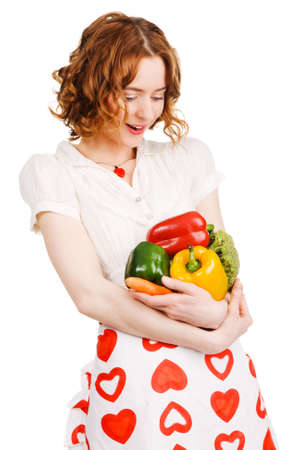 Young beautiful woman with a bunch of fresh vegatables, white background Stock Photo - 6823168