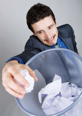 Young businessman playing baskteball with crumpled paper Stock Photo - 6922369
