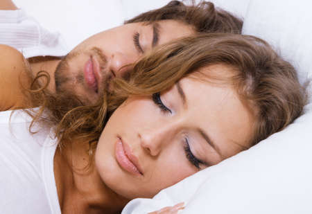Young beautiful couple sleeping in bed Stock Photo - 6922370