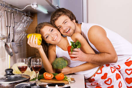 Young beautiful couple in their kitchen photo