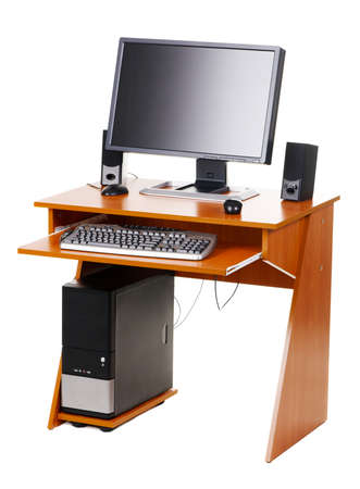 Modern personal computer on a table, isolated on white background photo