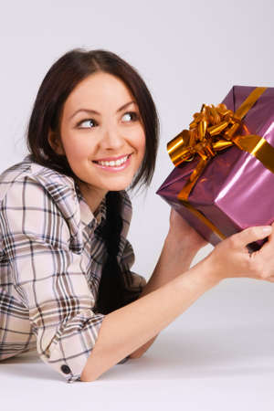 Beautiful brunette with a gift box photo