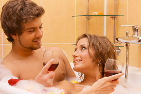 Beautiful young couple enjoying a bath with rose petals Stock Photo - 7012821