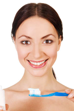 Beautiful young woman holding toothpaste and toothbrush, white background Stock Photo - 7012815