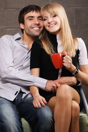 Young cheerful couple on brick wall background Stock Photo - 7092343