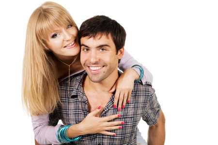Beautiful young couple in casual clothing, white background Stock Photo - 7092294
